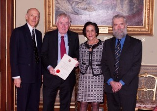 Governor invests new Distinguished Fellow